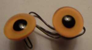 Straw-colored Glass Bird Eyes on a wire